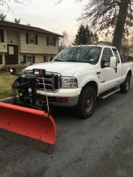 2002 Ford F 250 with a 8ft western plow for sale