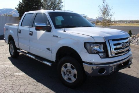 damaged 2010 Ford F 150 XLT Supercrew 4WD pickup for sale