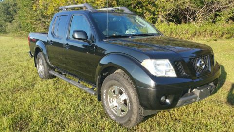has few dents  2011 Nissan Frontier Pro4X pickup for sale