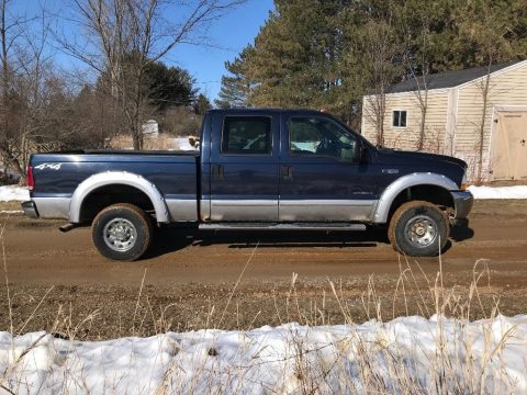 rusty 2003 Ford F 350 pickup for sale