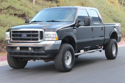 lifted 2002 Ford F 350 Lariat CREW CAB Short BED 7.3L Diesel 4X4 pickup for sale