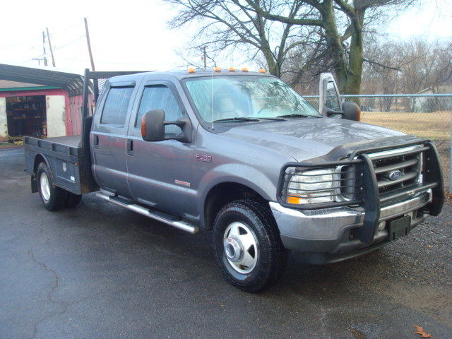 loaded 2004 Ford F 350 LARIAT flatbed pickup