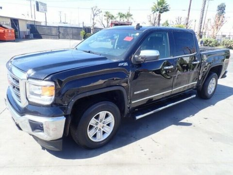 damaged 2015 GMC Sierra 1500 SLT pickup for sale