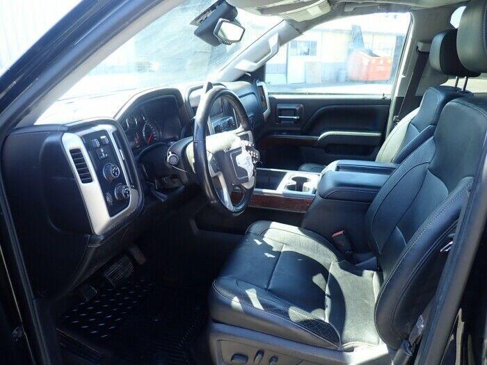 damaged 2015 GMC Sierra 1500 SLT pickup